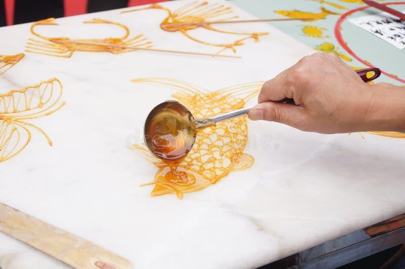 Chinesische traditionelle Volkskunst: Handgemachter Zucker lizenzfreies stockbild