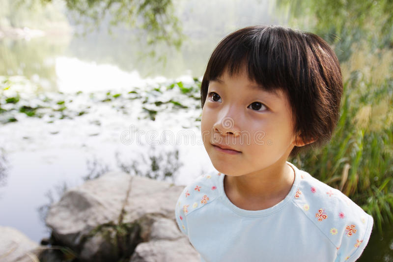 Chinesisches Gesicht des kleinen Mädchens stockfoto