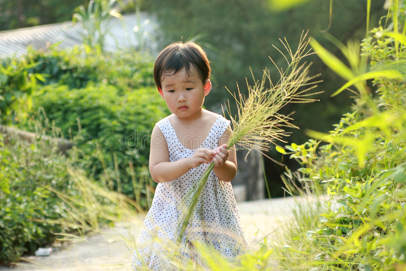 Chinesisches Kindspielen. stockfotografie