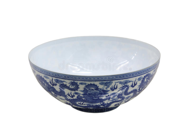Chiness blue and white bowl. Blue and white egg-shell bowl with wine dragons pattern isolated on white royalty free stock images