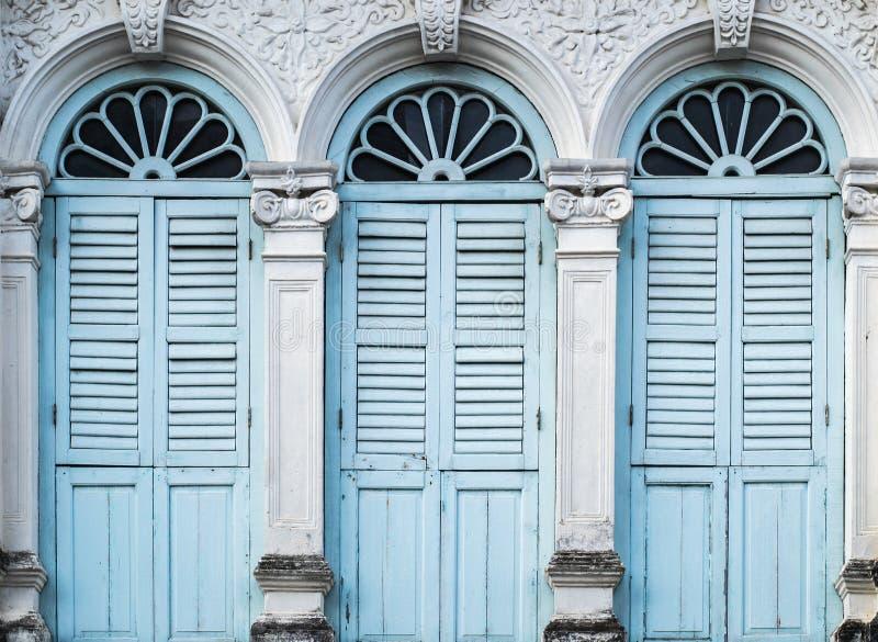 Chino Portuguese style architecture. Retro wooden windows and decoration in Chino Portuguese style architecture stock photography
