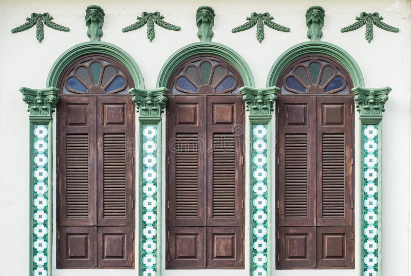 Chino Portuguese style architecture. Retro wooden windows and decoration in Chino Portuguese style architecture royalty free stock photos