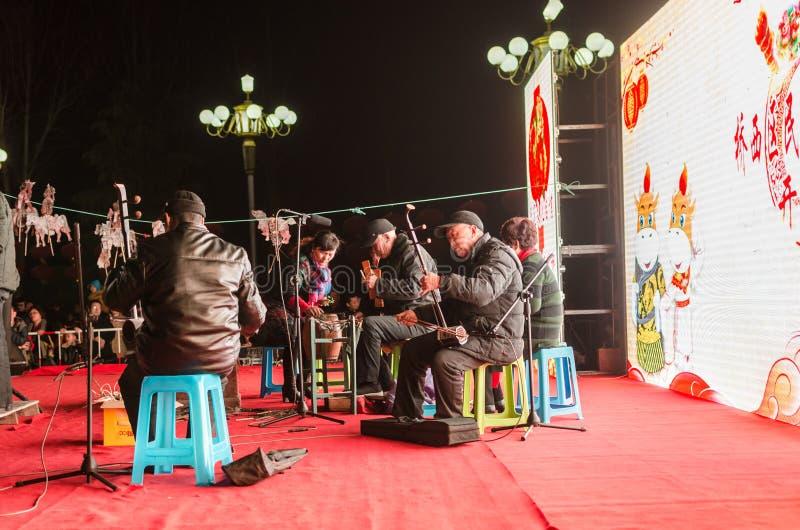 ` Chinois de jeu d'ombre de ` d'art populaire photo stock