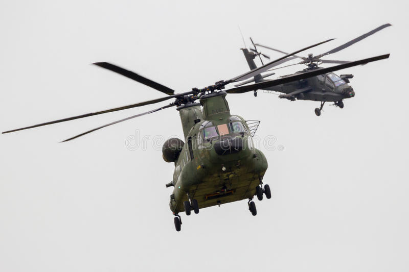 Chinook Apache helicopter. Chinook and Apache helicopter flying during the Royal Netherlands Air Force Days royalty free stock photos