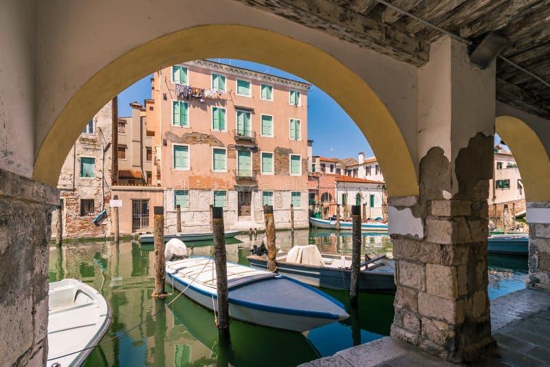 Chioggia glimpse from the arcades. Chioggia glimpse from the arcades along the canals royalty free stock photography