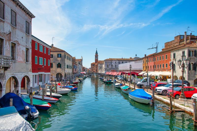 Chioggia Italy, on the Vena canal in the background the church of San Giacomo.  royalty free stock photo