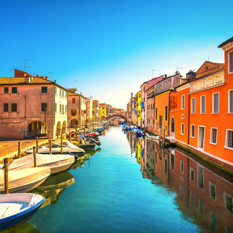 Chioggia town in venetian lagoon, water canal and church. Veneto, Italy. Europe stock image
