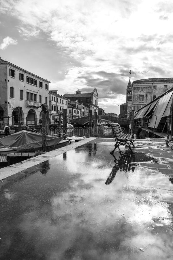 Chioggia, Venice, Italy: landscape of the old town and the canal with fishing boats and ancient buildings. Black And White Photogr royalty free stock photography