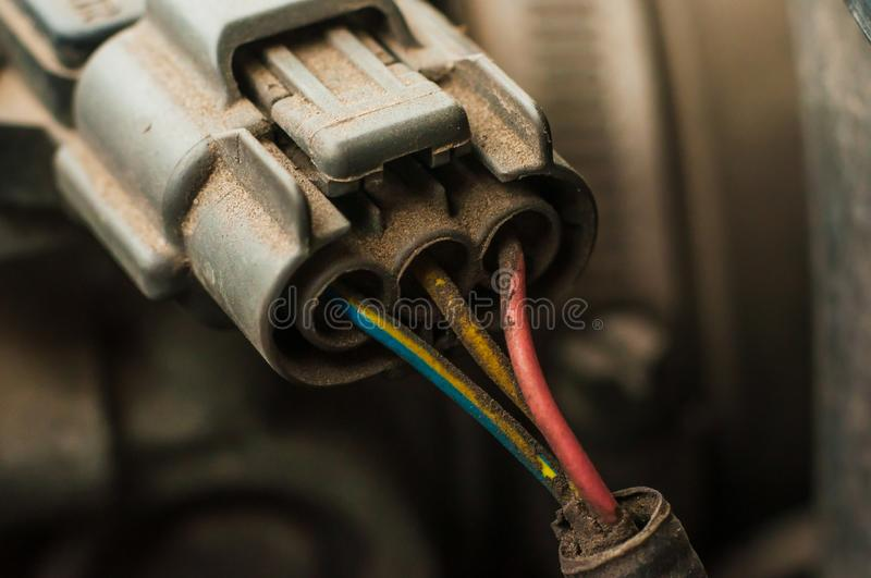 Chip connecting electrical equipment under the hood of the car. Dusty and dirty engine compartment royalty free stock image