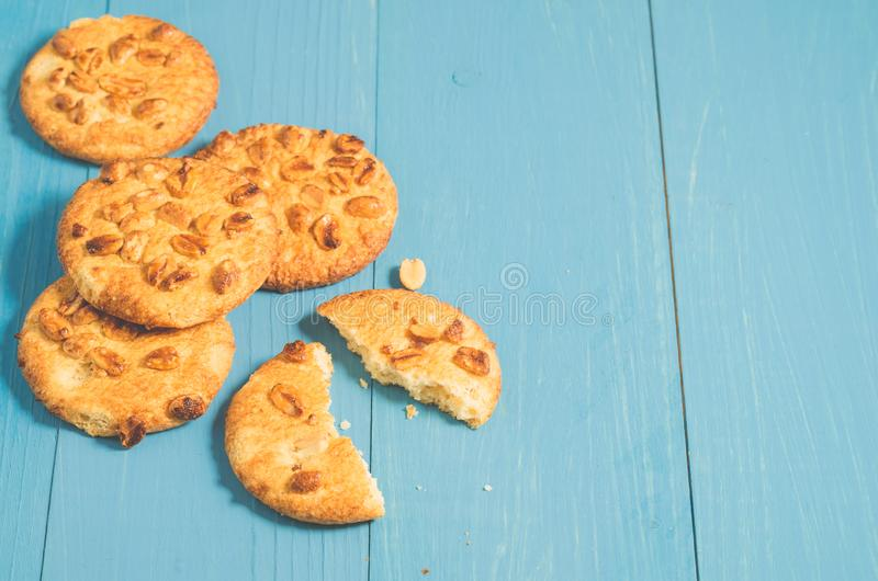 Chip cookies with nuts/chip cookies with nuts on a blue wooden b. Ackground, copy space royalty free stock photo
