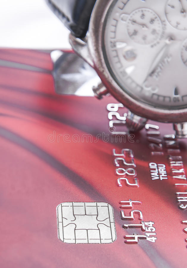 Chip of Credit cards and a watch up close. Credit cards and a watch up close stock photography