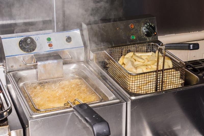Chip Fryers com microplaqueta imagem de stock royalty free