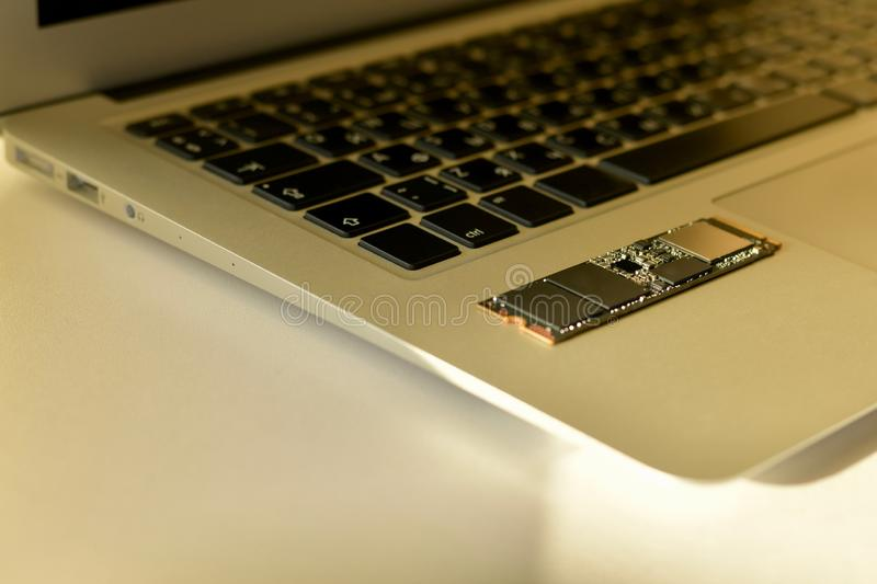 Chip SSD-drive in the soft light of the beam. royalty free stock photography