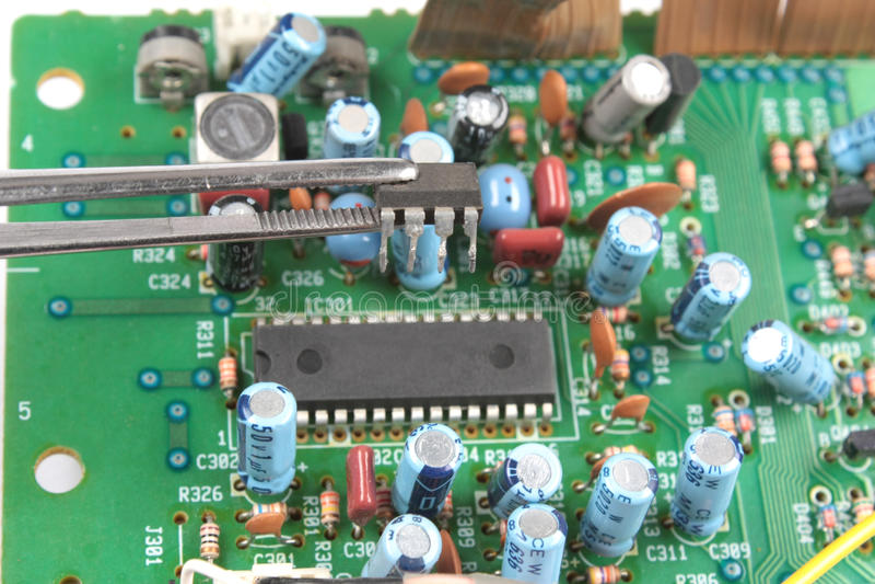 Download Chip in tweezers stock photo. Image of capacitor, transistor - 12073992