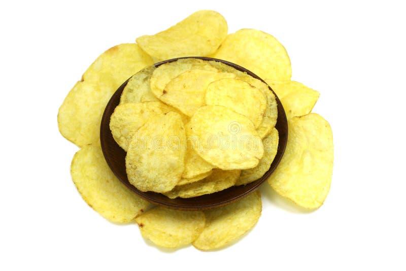 chip in un piatto di legno fotografia stock libera da diritti