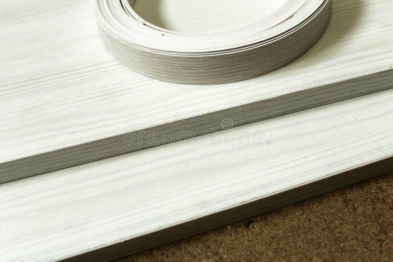 chipboard Het plastic rand verpakken van meubilair royalty-vrije stock afbeelding