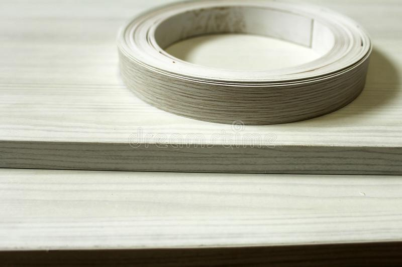 Chipboard. Plastic edge wrapping of furniture. Chipboard. Plastic and paper edge wrapping of furniture royalty free stock photo