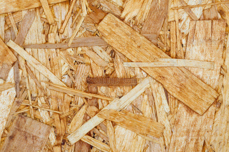 Chipboard. Pressed chips. Close-up royalty free stock images