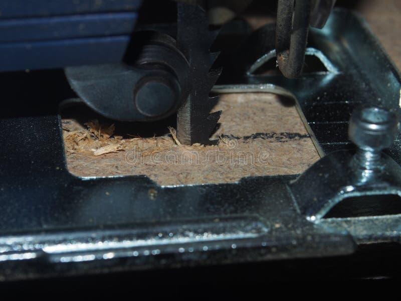 Chipboard sawn PR using an electric jigsaw. royalty free stock image