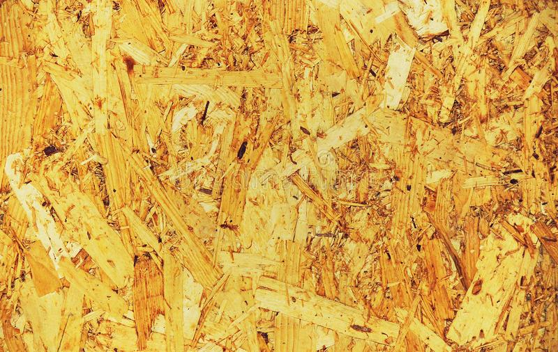 Chipboard in warm colors. Building sheet of chipboard in warm colors stock photos