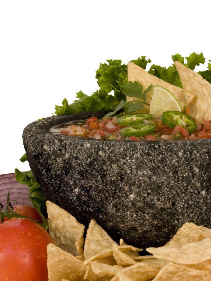 chiper stänger upp salsa royaltyfri bild