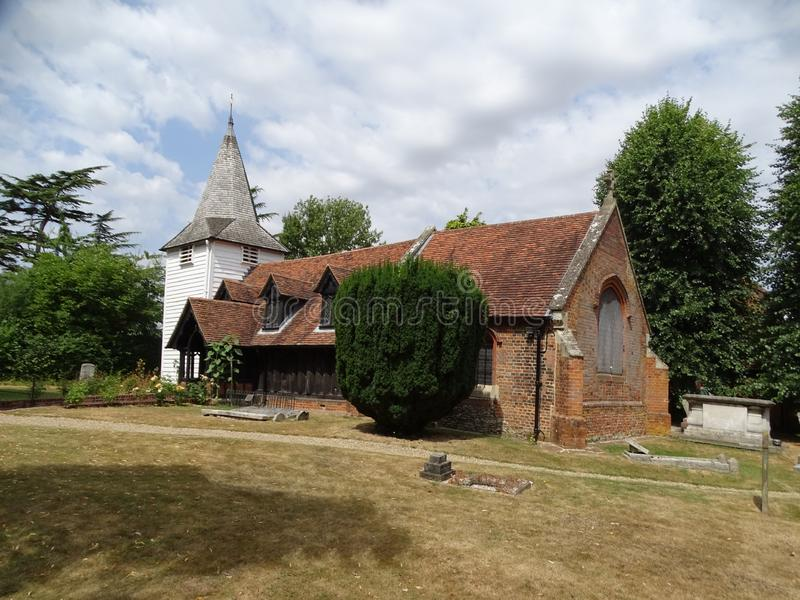 Reputedly the oldest wooden church in the world in a rural village called Greensted. Chipping Ongar, Essex, England-July 19, 2018: Reputedly the oldest wooden royalty free stock image