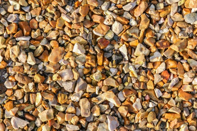 Chippings de piedra coloreados de oro foto de archivo libre de regalías