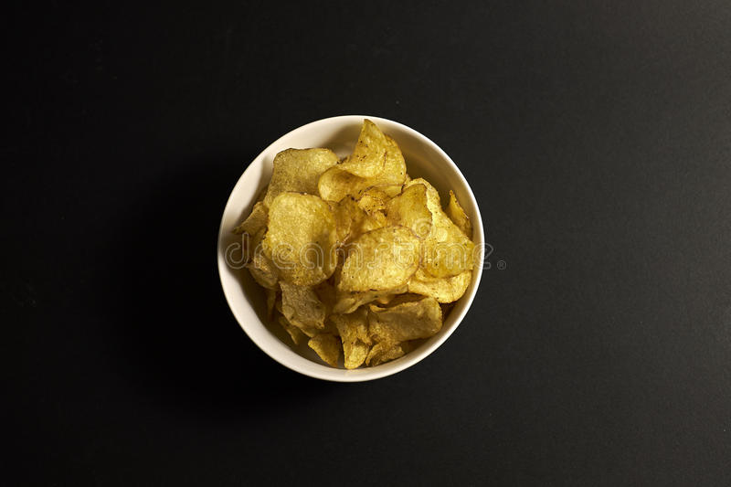 Chips in a bowl stock photos