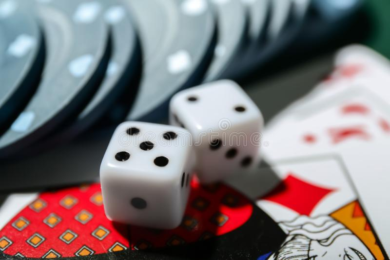 Chips with cards and dices for poker game, closeup royalty free stock images