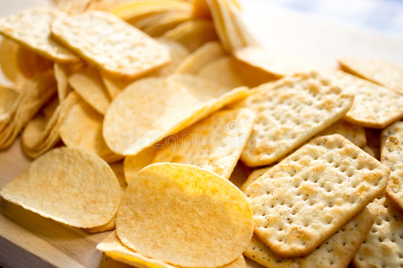 Chips and crackers stock images