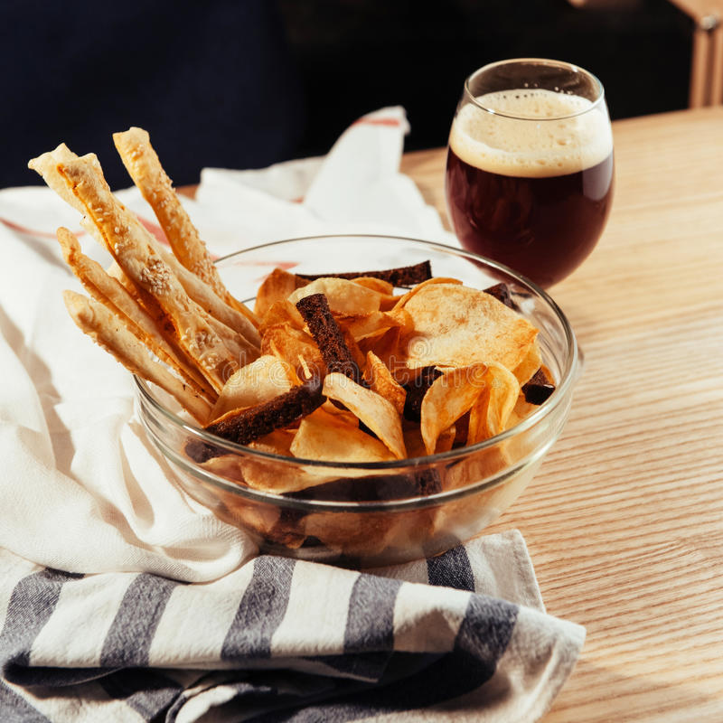 Chips and crackers to beer. Advertising shooting menu.  stock photo