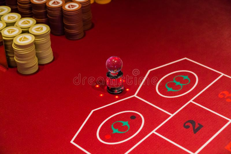 Chips on the Craps Table. Chips sitting on a red craps table in a casino stock image