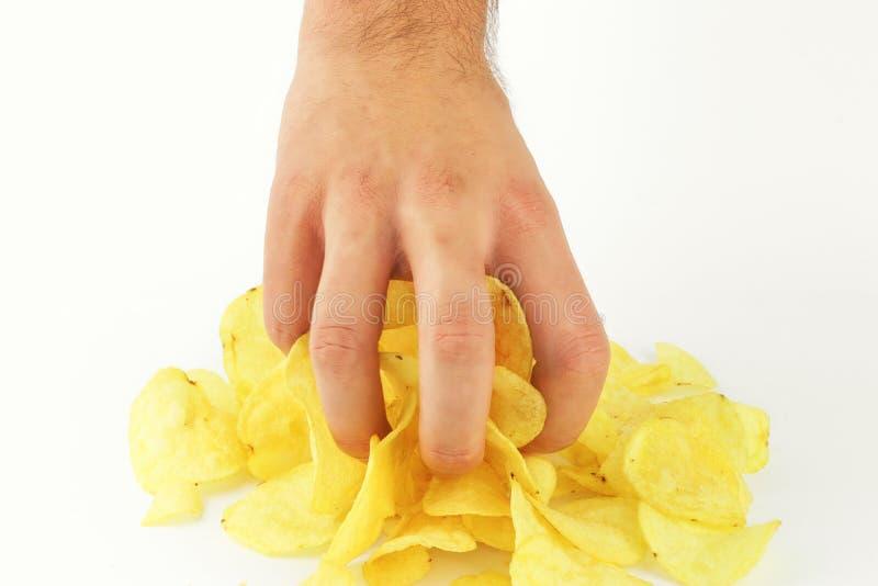 Chips in der Hand auf dem weißen Hintergrund lizenzfreies stockbild