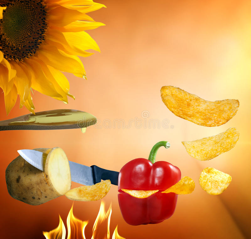 Chips factory with paprika and potatoes royalty free stock photos