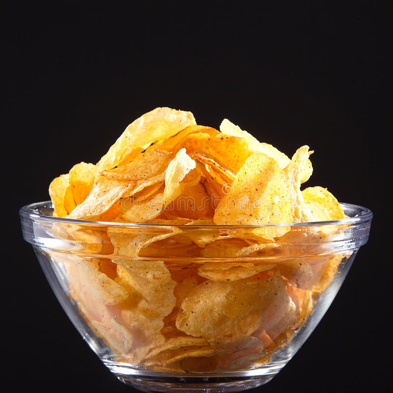 Chips. Fresh chips in glass bowl stock images