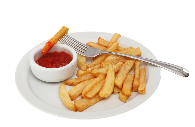 Chips on a plate royalty free stock image
