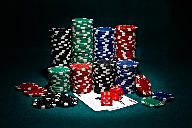 Chips for poker with pair of aces and dice royalty free stock photos