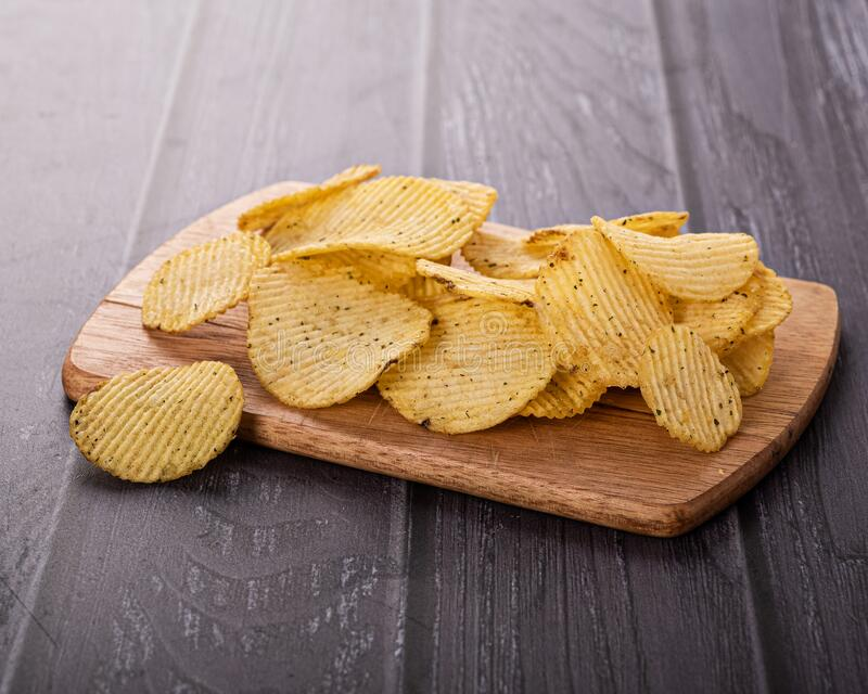 Chips on a wooden Board royalty free stock image