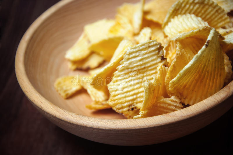 Chips in wooden dish royalty free stock images