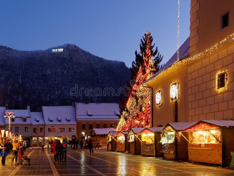 Chiristmas market in Brasov, Romania. Brasov / Romania - 12 16 2016: From the end of November until Christmas, Piata Sfatului in Brasov transforms into a magical stock photography