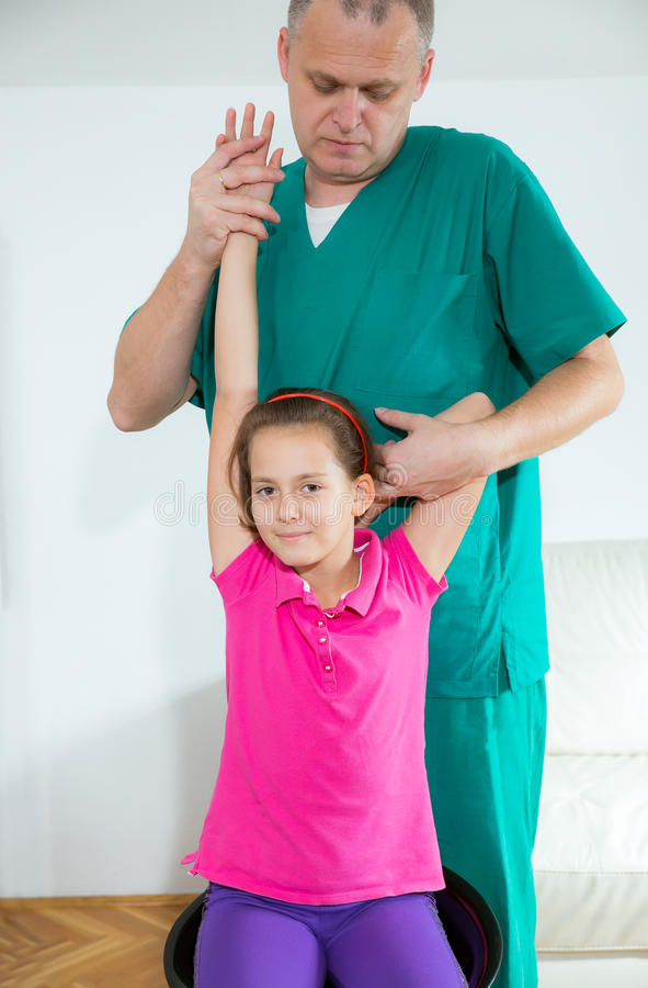 Chiropractor doing adjustment on female patient. In doctor's office royalty free stock photos