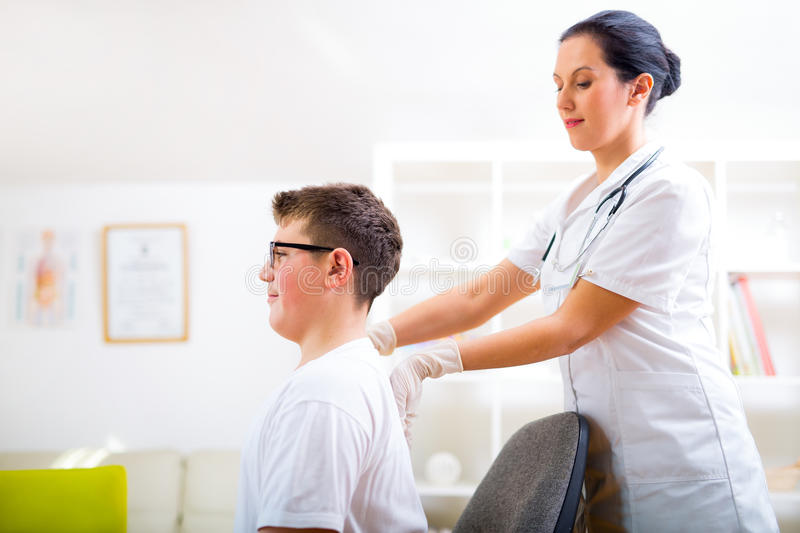 Chiropractor doing adjustment on male patient. At doctor's office royalty free stock photos