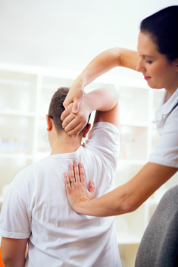 Chiropractor doing adjustment on patient. Chiropractor doing adjustment on male patient stock image