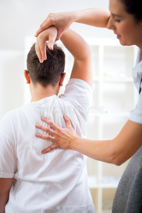 Chiropractor doing adjustment on patient. Chiropractor doing adjustment on male patient stock photography