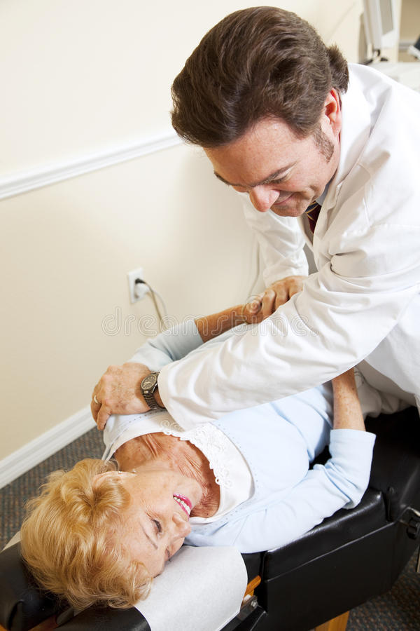 Chiropractor Relieves Pain royalty free stock photos