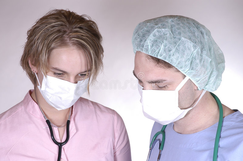 Chirurg Und Krankenschwester Stockfotografie