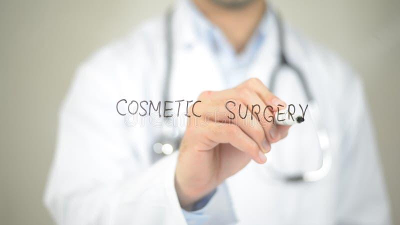 Chirurgie esthétique, écriture de docteur sur l'écran transparent image libre de droits