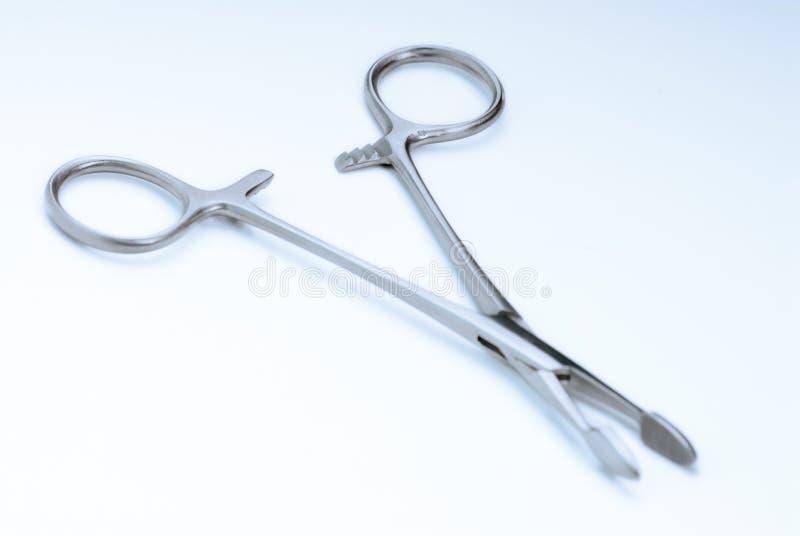Chirurgische Rohrschellen stockfotos