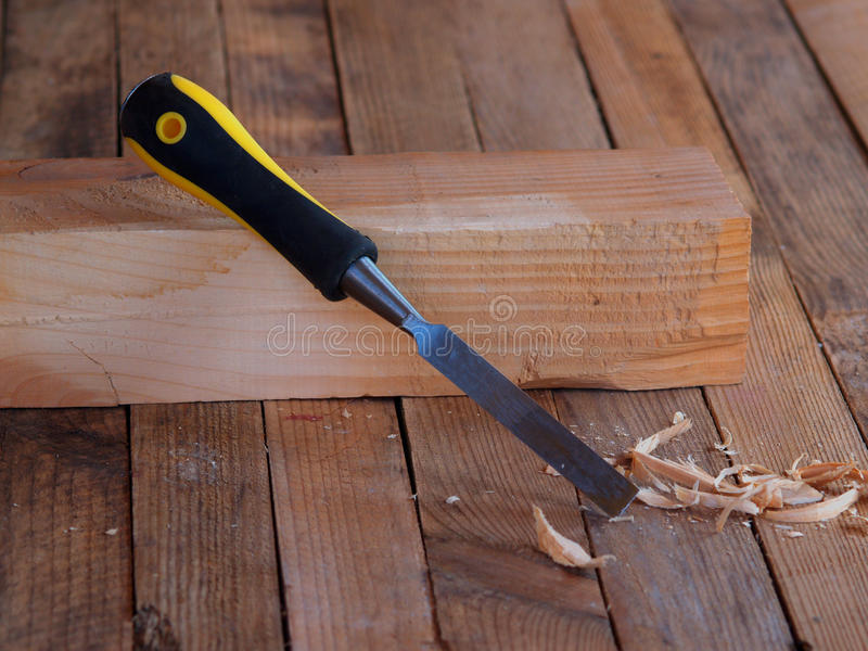 Chisel. On the wood. Wooden planking background stock images