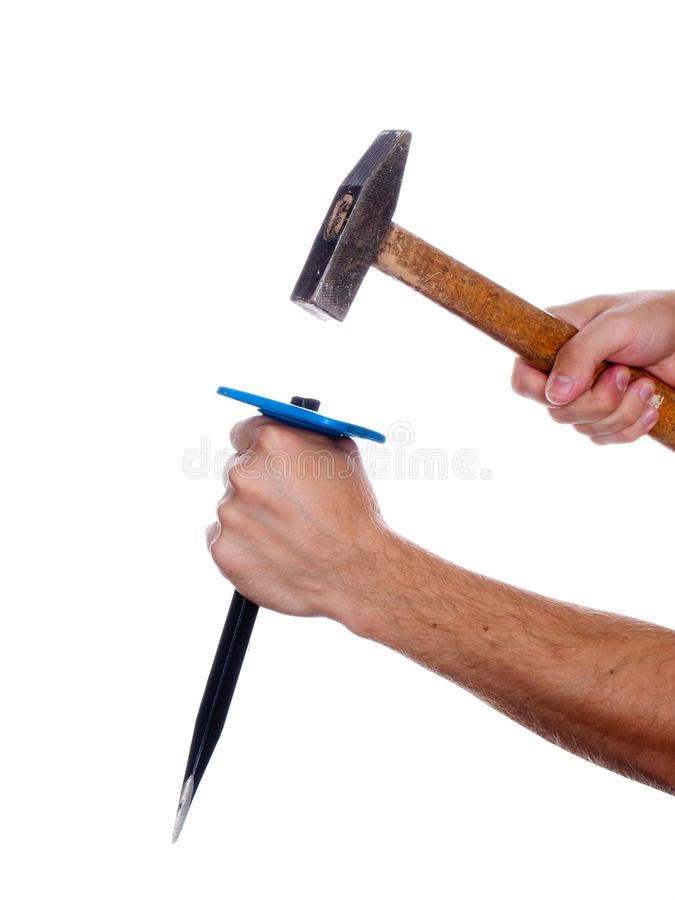 Chisel and hammer in hand stock photography